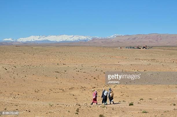 Berber Women Walking in Desert