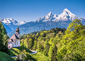 Beautiful mountain landscape in the Bavarian Alps with pilgrimage church of Maria Gern and Watzmann massif in the background, Nationalpark Berchtesgadener Land, Bavaria, Germany