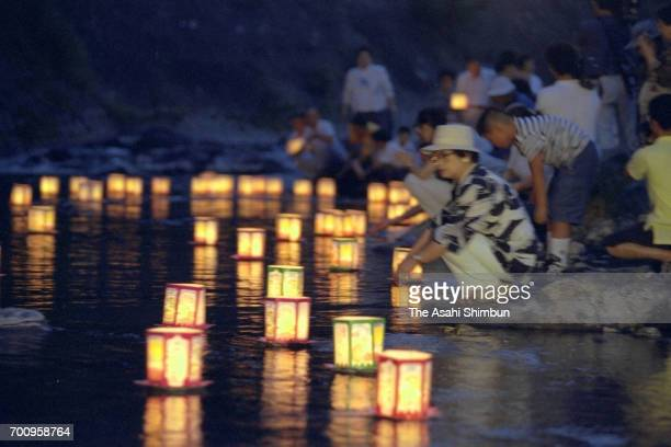 Bereaved family members float candlelit lanterns to Kanna River to commemorate the victims ahead of the 10th anniversary of the JAL 123 air crash on...