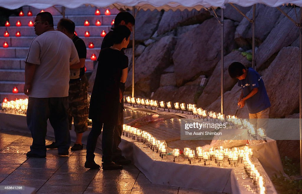 Bereaved family members pray for the victims on the 29th anniversary of the JAL 123 air crash on August 12 2014 in Ueno Gunma Japan Japan Airlines...