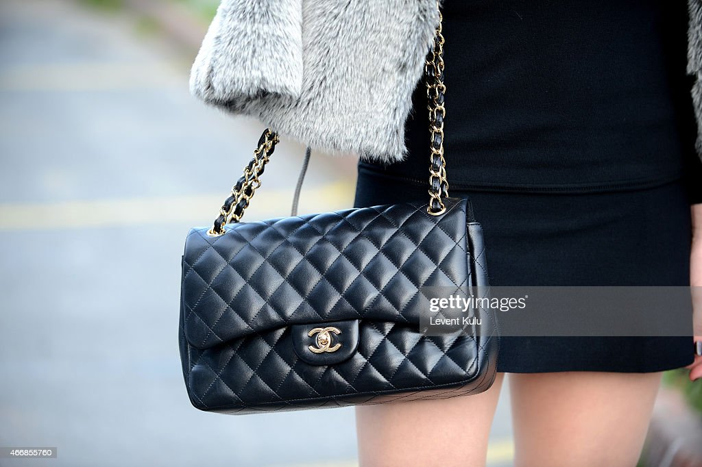 Berel Beskurt poses wearing hand bag by Chanel during Mercedes Benz Fashion Week Istanbul FW15 on March 19 2015 in Istanbul Turkey