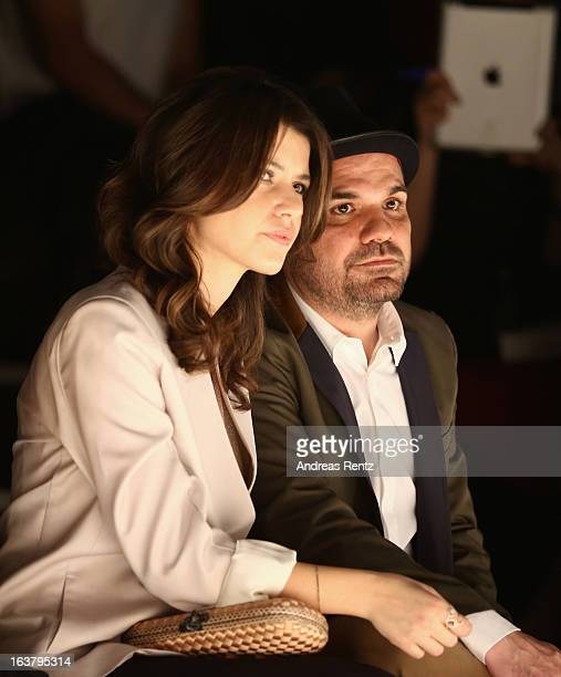 Beren Saat and Kenan Doguluthe attend the runway at the Soul By Ozgur Masur show during MercedesBenz Fashion Week Istanbul Fall/Winter 2013/14 at...
