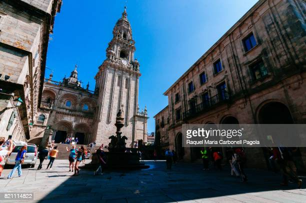 Berenguela tower of the Cathedral of Santiago and Santiago de Compostela statue and fountain in Praterías square