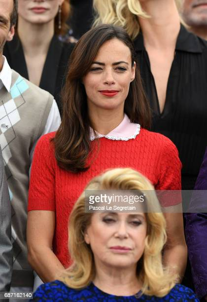 Berenice Bejo and Catherine Deneuve attend the 70th Anniversary Photocall during the 70th annual Cannes Film Festival at Palais des Festivals on May...