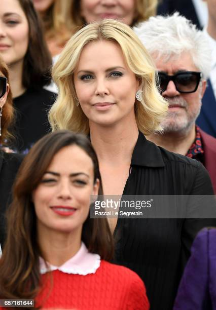 Berenice Bejo Charlize Theron and Pedro Almodovar attend the 70th Anniversary Photocall during the 70th annual Cannes Film Festival at Palais des...