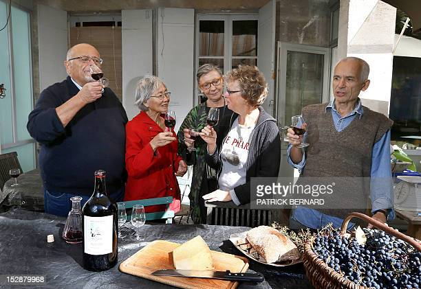 FRAYSSE Berenice Chang Ricard and relatives drink the wine they prepared a previous year after harvesting grapes in the garden of their house on...