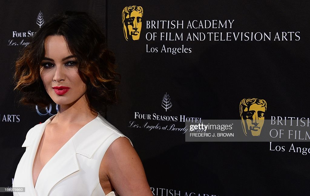 Berenice Marlohe poses on arrival for the British Academy of Film and Television Arts (BAFTA) Los Angeles Awards Season Tea Party on January 12, 2013 in Beverly Hills, California. AFP PHOTO / Frederic J. BROWN