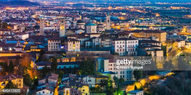 Bergamo, Italy. High angle view of the illuminated cityscape at dusk.