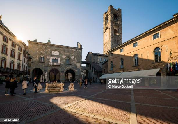 Bergamo, Italy. People in the town square of Piazza Vecchia in Città Alta.