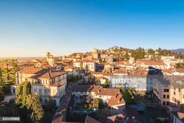 Bergamo, Lombardy, Italy. High angle view over Upper Town (Città Alta) at sunset.