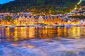 Bergen's Port timber houses in midnight sun, long exposure makes the water smooth.