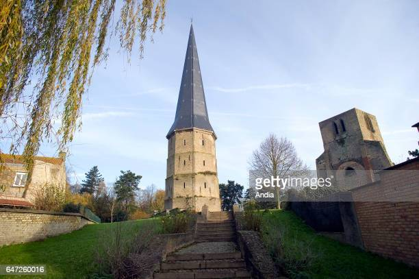 remains of the Benedictine Abbey of St Winoc The sharp tower and the square tower