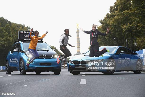 Berhane Dibaba of Ethiopia Aberu Kebede of Ethiopia and Katharina Heinig of Germany poses in front of the BMW i3 and BMW i8 at the Siegessaeule on...