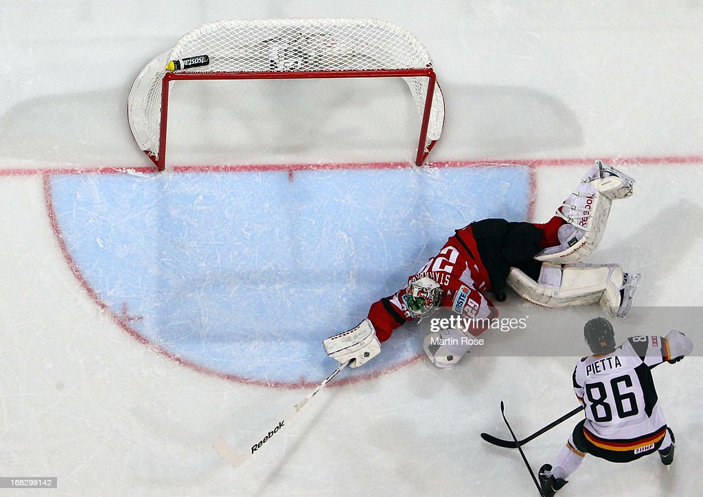Berhard Starkbaum (C), goaltender of Austria makes a save on Daniel Pietta (#86) of Germany during the IIHF World Championship group H match between Austria and Germany at Hartwall Areena on May 8, 2013 in Helsinki, Finland.