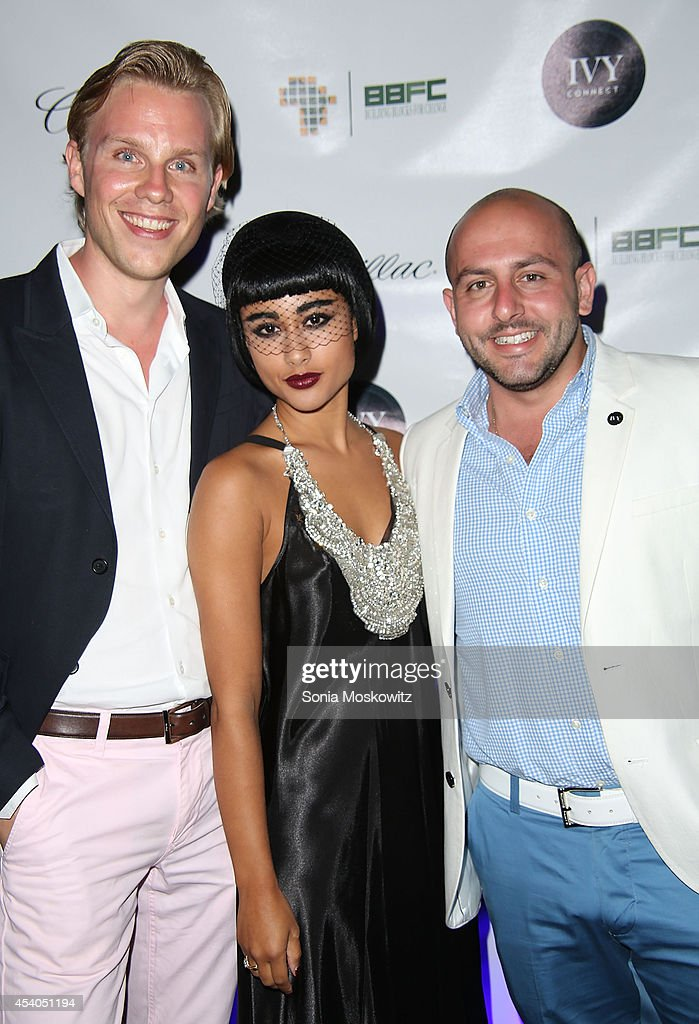 Beri Meric, <a gi-track='captionPersonalityLinkClicked' href=/galleries/search?phrase=Natalia+Kills&family=editorial&specificpeople=6915479 ng-click='$event.stopPropagation()'>Natalia Kills</a>, and Philipp Triebel attend the 2014 Hamptons Summer Soiree Charity Benefit for Building Blocks for Change hosted by IvyConnect at Private Residence on August 23, 2014 in Southampton, New York.