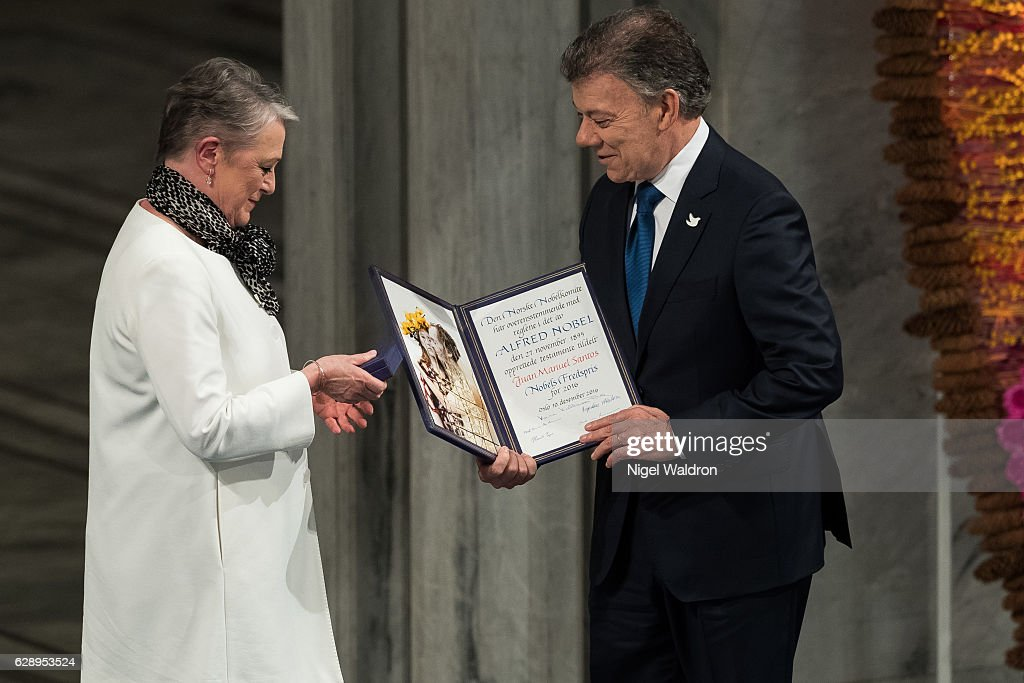 Berit Reiss-Andersen of Norway, President Juan Manuel Santos of Colombia receives his Nobel Peace Prize Award during the Nobel Peace Prize ceremony at Oslo Town Hall on December 10, 2016 in Oslo, Norway.
