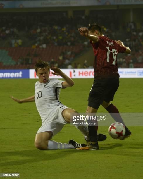 Berk Cetin of Turkey U17 in action against Ebbinge of New Zealand U17 during the FIFA U17 World Cup India 2017 football match between Turkey U17 and...