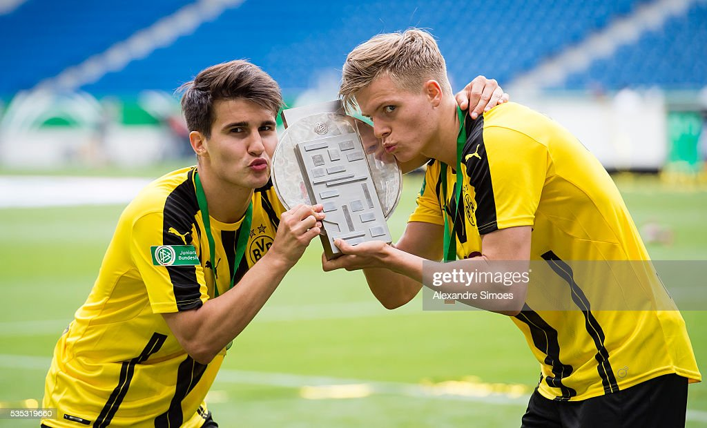 Berkant Guener, l., and Dzenis Burnic of Dortmund celebrate with the trophy after the A Juniors German Championship Final match between 1899 Hoffenheim U19 and Borussia Dortmund U19 at Wirsol Rhein-Neckar-Arena on May 29, 2016 in Sinsheim, Germany.