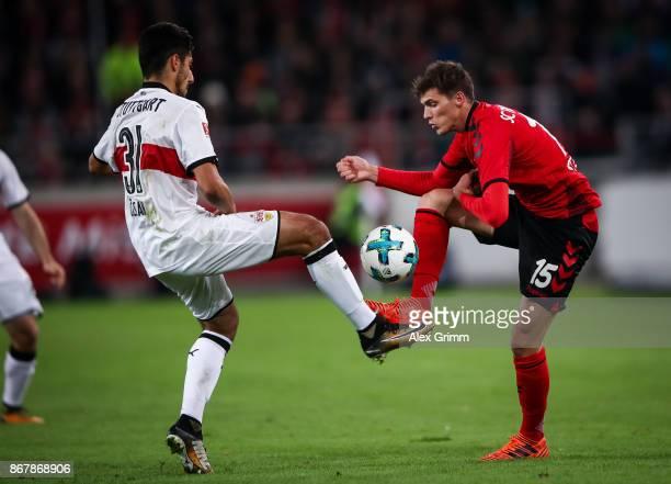 Berkay Oezcan of Stuttgart and Pascal Stenzel of Freiburg battle for the ball during the Bundesliga match between VfB Stuttgart and SportClub...