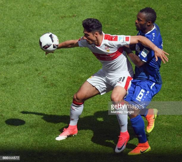 Berkay Oezcan of Stuttgart is challenged by Franck Kom of Karlsruhe during the Second Bundesliga match between VfB Stuttgart and Karlsruher SC at...