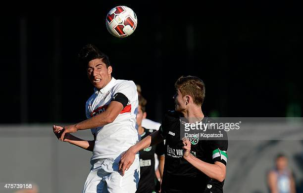 Berkay Oezcan of Stuttgart jumps for a header with GeorgRichard Koenig of Hannover during the BJuniors Bundesliga semi final match between U17 VfB...