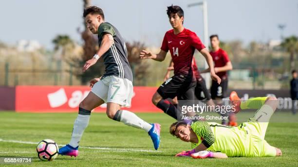 Berke Oezer of Turkey challenges NicolasGerrit Kuehn of Germany during the UEFA U17 elite round match between Germany and Turkey on March 28 2017 in...