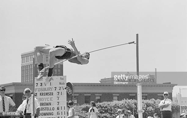 Dick Fosbury an upside down jumper from Oregon State gets his tail over the bar at 7 ft 31/4 inches 1/2 inch less than the American Record but his...