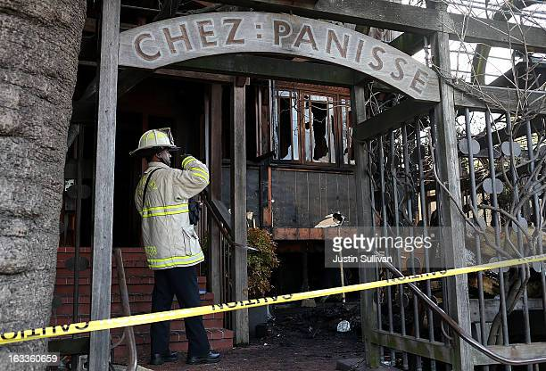 Berkeley Fire Department fire chief takes a photo of fire damage after an early morning fire at Chez Panisse restaurant on March 8 2013 in Berkeley...