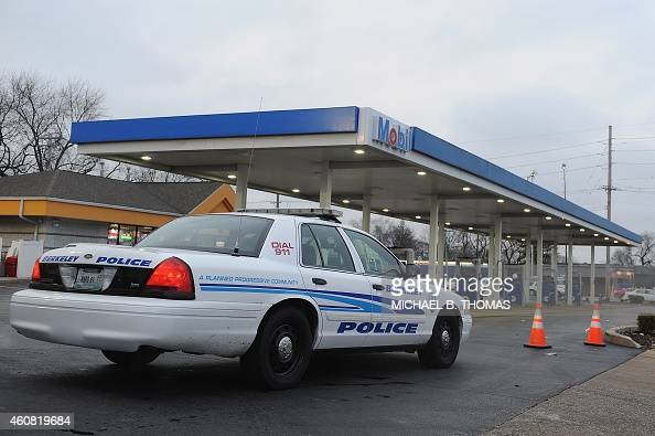 A Berkeley Police cruiser sits on the Mobil OnTheRun gas and convenience store in Berkeley Missouri on December 24 2014 In the latest incident to...