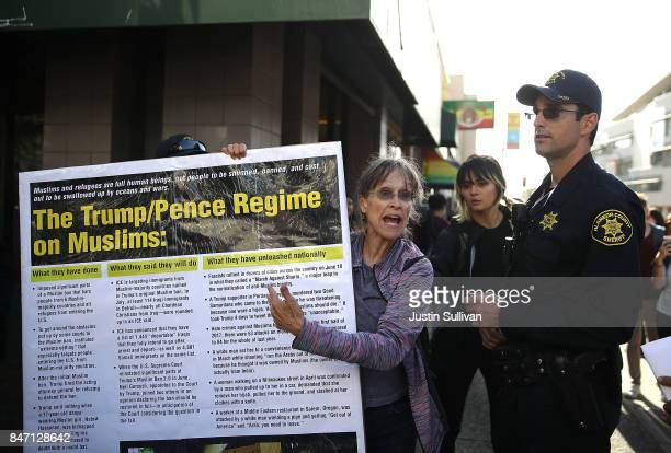 Berkeley police officer confronts a protester for having an unauthorized sign during a demonstration outside of Zellerbach Hall on the UC Berkeley...