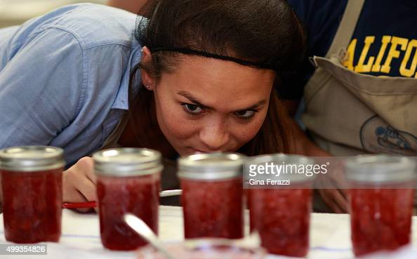 Berkeley student Ophelia Pedersen peers over finished jars of raspberry jam during class on fermentation and preservation on October 29 2015 in...