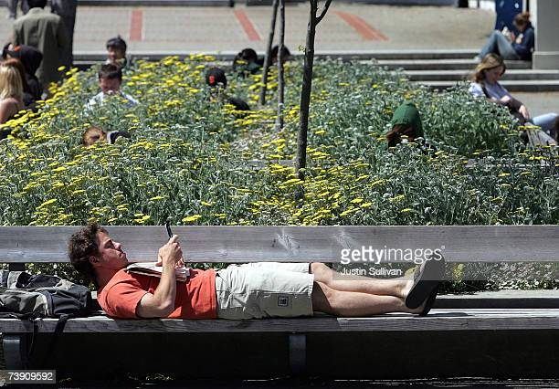 Berkeley student uses a handheld device while lounging on the UC Berkeley campus April 17 2007 in Berkeley California Robert Dynes President of the...