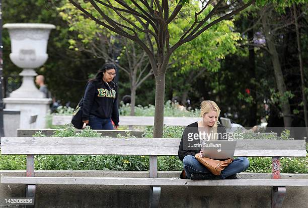 Berkeley student works on her laptop while sitting on the UC Berkeley campus April 23 2012 in Berkeley California According to reports half of all...