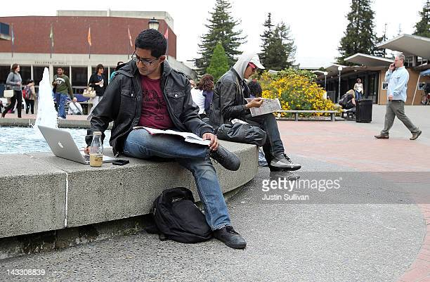 Berkeley student works on his laptop while sitting in Sproul Plaza on the UC Berkeley campus April 23 2012 in Berkeley California According to...