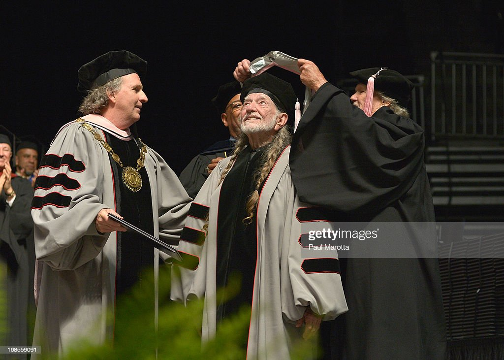 Berklee College of Music President Roger Brown (L) Lawrence Simpson and Kris Kristofferson (R) confer an Honorary Doctor of Music Degree on WIllie Nelson (C) take part in the 2013 Berklee College Of Music Commencement Ceremony at Berklee College of Music on May 11, 2013 in Boston, Massachusetts.