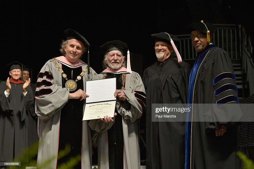 Berklee College of Music President Roger Brown (L) Lawrence Simpson and Kris Kristofferson (R) confer an Honorary Doctor of Music Degree on WIllie Nelson (C) during the 2013 Berklee College Of Music Commencement Ceremony at Berklee College of Music on May 11, 2013 in Boston, Massachusetts.