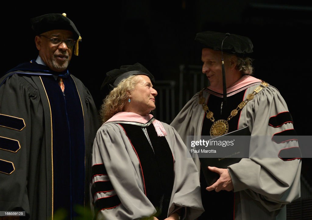 Berklee College of Music Senior Vice President Lawrence Simpson (L) and Berklee President Roger Brown (R) confer an Honorary Doctor of Music Degree on Carole King (C) during the 2013 Berklee College Of Music Commencement Ceremony at Berklee College of Music on May 11, 2013 in Boston, Massachusetts.
