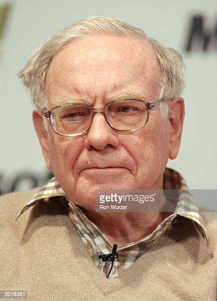 Berkshire Hathaway Chairman Warren Buffett attends a media briefing during the seventh annual CEO Summit at Microsoft's campus May 21 2003 in Redmond...