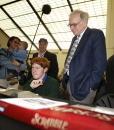 Berkshire Hathaway's CEO Warren Buffett looks on as John Calahan of Lincoln Nebraska plays Peter Morris in Scrabble before a news conference May 4...