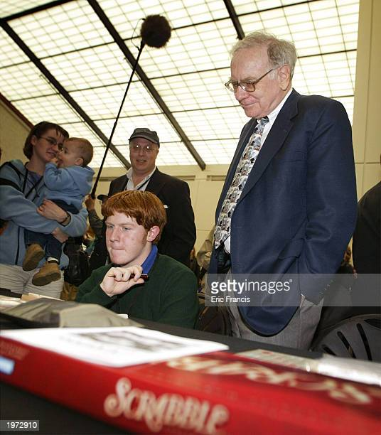 Berkshire Hathaway's CEO Warren Buffett looks on as John Calahan of Lincoln Nebraska plays Peter Morris in Scrabble before a news conference May 4...