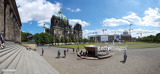 Berlin Cathedral and television tower - people on  meadow
