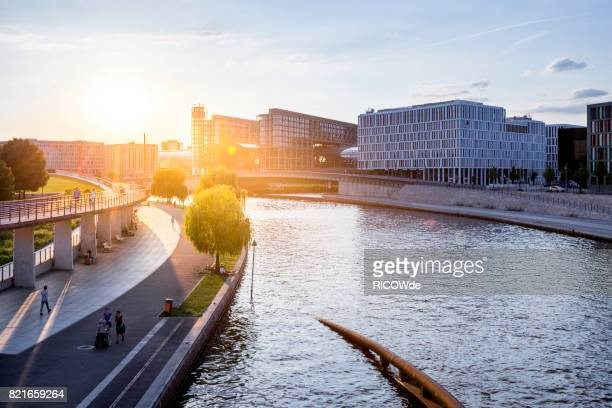 Berlin central station with spree river and sunset