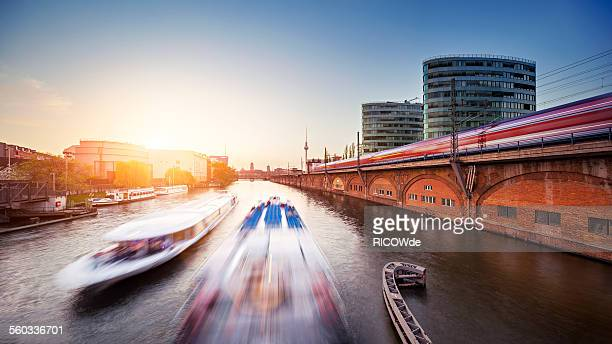 Berlin cityscape at sunset with ships train