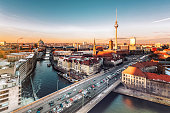 berlin cityscape with television tower under at sunset hour