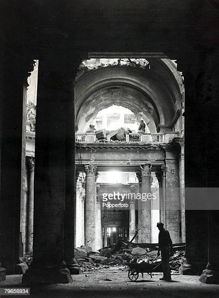 Berlin East Germany 1st September 1948 A German worker wheeling a barrowload of debris in the ruined entrance hall of the old bombscarred Reichstag...