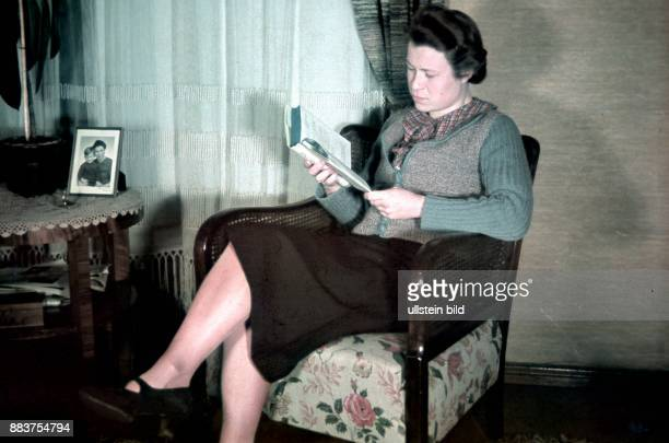 Berlin family at home celebrating Christmas woman reading a book