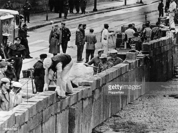 Berlin Germany 20th November East German workers laying bricks during the building of the new wall in Berlin to divide East and West of the city at...
