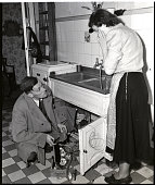 5/2/1949 Berlin Germany Ach du lieber This West Berlin housewife has been caught with the goods a condenser through which she is getting electricity...