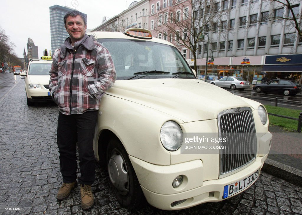 berlin taxi driver wolfgang slipek poses next to his. Black Bedroom Furniture Sets. Home Design Ideas