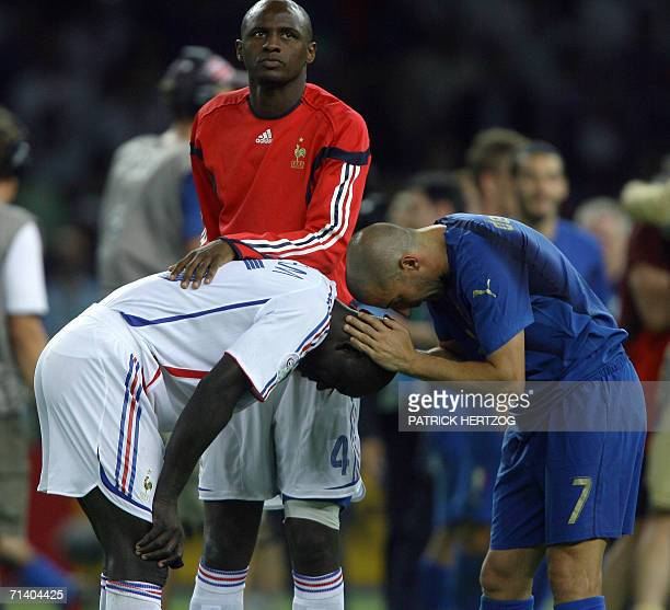 French defender Lilian Thuram is consoled by French midfielder Patrick Vieira and Italian forward Alessandro Del Piero following the World Cup 2006...